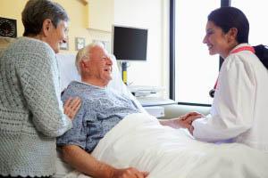 Doctor speaking with elderly patient