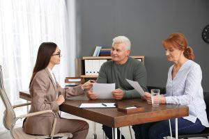 Lawyer consulting senior couple in office
