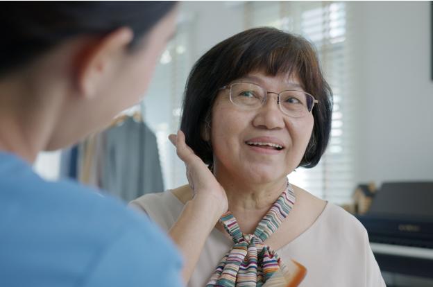Elderly woman touching hair