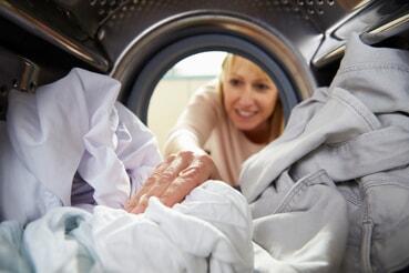woman reaching into dryer