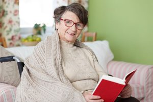 senior woman sitting and reading a book