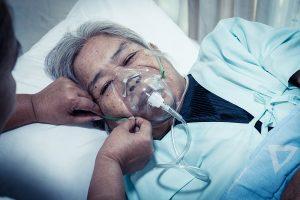 senior woman wearing breathing mask
