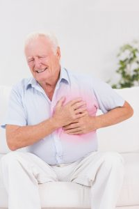 Aged man suffering with heart attack