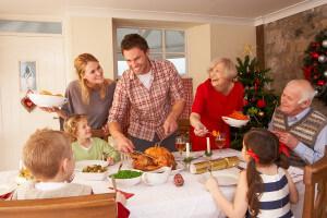Happy family enjoying Christmas dinner