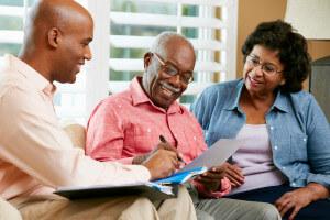 Financial advisor talking to senior man