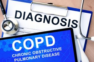 Diagnosis form and COPD words on blue board