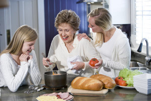 Grandmother cooking with family