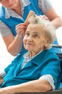 senior woman getting her hair combed