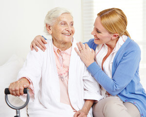 Elderly woman with caregiver