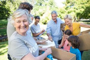 people volunteering and senior woman smiling