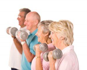 Senior people lifting dumbells