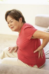 Senior woman suffering from back pain