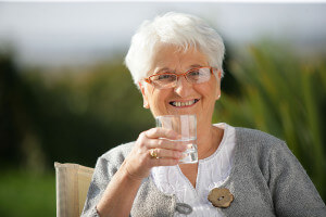 Senior woman holding a glass of water