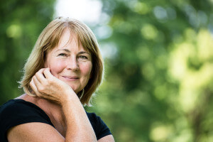 Smiling mature woman in black shirt