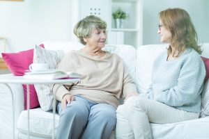 Elderly woman and adult woman talking