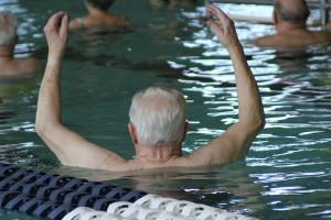 Elderly man doing water aerobics