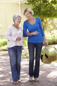 Woman helping elderly lady