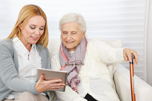 Woman giving senior woman instructions