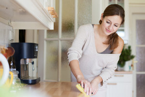 Young woman doing housework.
