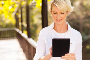 Woman readiing on a tablet