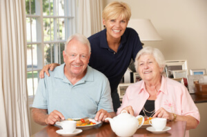 Elderly couple with caregiver