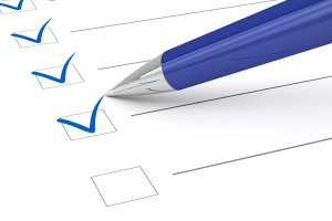 pen checking off boxes
