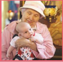 elderly woman holding baby