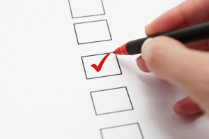 checkboxes being checked off with red pen